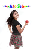 Back to School Happy Teen Girl with Apple Royalty Free Stock Photography