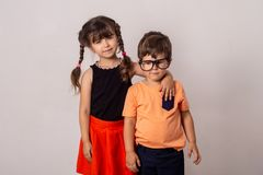 Back to school and happy time! Cute industrious children. stock photos