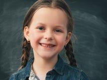 Back to school happy young girl chalkboard stock image