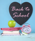 Back to School heart blackboard with bright pink and colorful stationery Royalty Free Stock Image