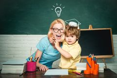 Back to school. Home schooling or private school. Female teacher and schoolboy in class at school. Elementary school stock photography