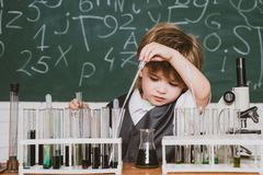 Back to school and home schooling. School chemistry lessons. Preschooler. Child in the class room with blackboard on. Background. Back to school royalty free stock photography
