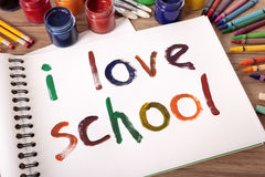 Back to school, I love school written on white paper book, school desk Stock Photo