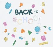 Back to school icons. Lettering back to school and various hand drawn school supplies isolated on white royalty free stock photo