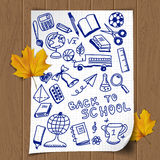 Back to school. Illustration with sketch school objects drawn on the note page Royalty Free Stock Image