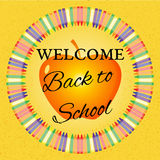 Back to school illustration. Welcome back to school text on a textured yellow background with a ring of colorful crayons and an apple Royalty Free Stock Images