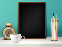 Back to school. Image with blackboard, pencils, cup and clock Royalty Free Stock Photos