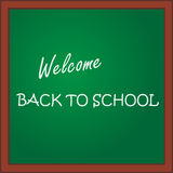 Back to school. Inscription on the green blackboard. Vector illustration. Art creative Royalty Free Stock Images