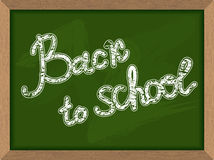 Back to school. Inscription on  Green chalk Blackboard. Chalk bo Royalty Free Stock Images