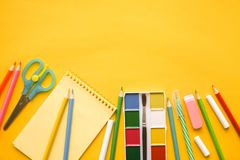 Back to school. Items for the school against yellow background. royalty free stock images