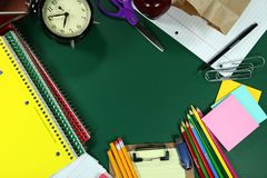 Back to School Items Arranged on a Green Blackboard Stock Photography