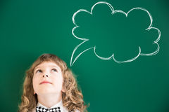 Back to school. School kid in class. Happy child against green blackboard. Education concept Stock Images