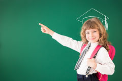 Back to school. School kid in class. Happy child against green blackboard. Education concept Stock Photography