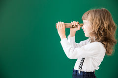 Back to school. School kid in class. Happy child against green blackboard. Education concept Royalty Free Stock Image