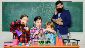 Back to school. kids in lab coat learning chemistry in school laboratory. chemistry lab. making experiment in lab or stock image