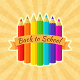 Back to School Label with Crayons. In rainbow colors. Emblem with retro ribbon and vintage background Stock Image