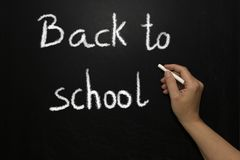 Back to school lettering over chalkboard black background stock photos