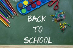 Back to school lettering over chalkboard black background royalty free stock photography