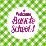 Vector card Back to school lettering. Round icon on a checkered background. Children`s design. Back to school lettering. Round icon on a green vichy checkered Stock Image