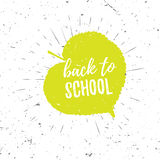 Back to school lettering typography on green linden leaf with burst on a old textured background. Hand drawn trendy. Design for a logo, greeting cards Royalty Free Stock Image