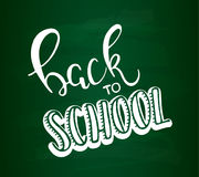 Back to school lettering vector illustration. Back to school calligraphy on chalkboard background Stock Photo