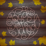 Back to school lettering with yellow maple leaf on wooden background Royalty Free Stock Images