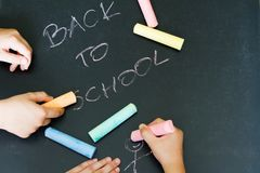 Back to school letters and drawing kids on blackboard. Abstract background royalty free stock photos