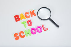 Back to school letters with magnifying glass Stock Photos