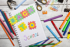 Back to school letters and office or student gear. Royalty Free Stock Image