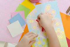 Back to school!. Little child hands sticking pieces of paper mosaic on the art lesson class. Children education concept. Kids crafts. Learn Study Education Royalty Free Stock Image