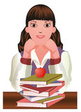 Back to School. Little cute schoolgirl and apple. Royalty Free Stock Photography