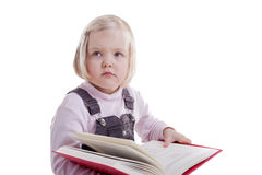 Back to school - little girl reading a book Stock Photo