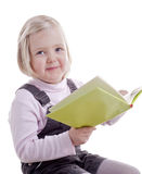 Back to school - little girl reading a book Stock Images