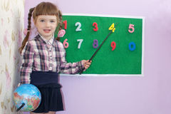 Back to school little girl school Board numbers and globe Royalty Free Stock Image