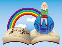 Back to School. Little schoolgirl with globe and old book Stock Photo