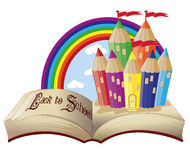 Back to School. Magic book and fabulous school castle Stock Photos