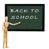 Back to school. Mannequin pointing to blackboard with the text back to school royalty free stock photos