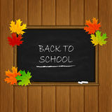 Back to School and maple leaves on black chalkboard Stock Photography