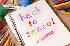 Back to school memo reminder written in book on desk. Stock Image