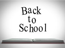 Back to school message above open book graphic Royalty Free Stock Image
