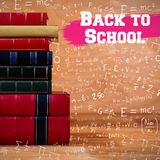 Composite image of back to school message. Back to school message against books stack on table Stock Photography
