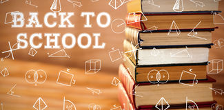 Composite image of back to school message. Back to school message against stack of various books Stock Photos
