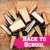 Composite image of back to school message. Back to school message against various type of books arranged Stock Image