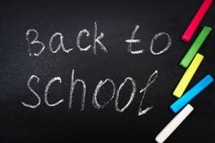Back to school message on Blackboard inscribed with colorful chalk for background. Stock Photography