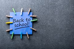 Back to school - Message at blue notice at dark background. Education concept, 1 september time stock photography