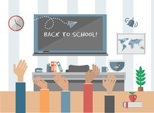 Back to school message on chalkboard in classroom Royalty Free Stock Photo