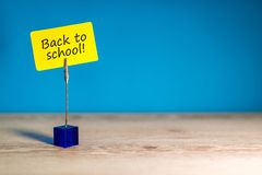 Back to school - Message at little nameplate at blue background. Education concept, 1 september time royalty free stock photography