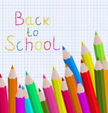 Back to school message with pencils on paper sheet Stock Image