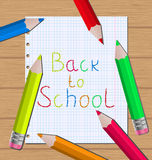 Back to school message with pencils on paper sheet Stock Images