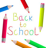 Back to school message with pencils on white backg Royalty Free Stock Photography
